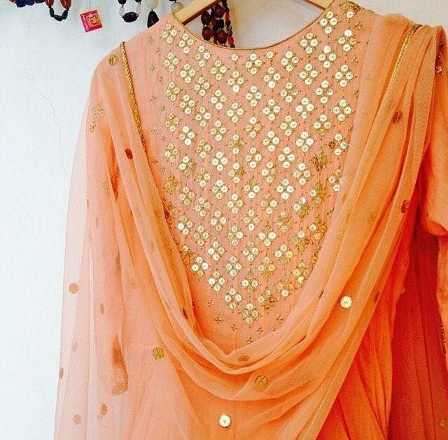 color orange coral gold net suit