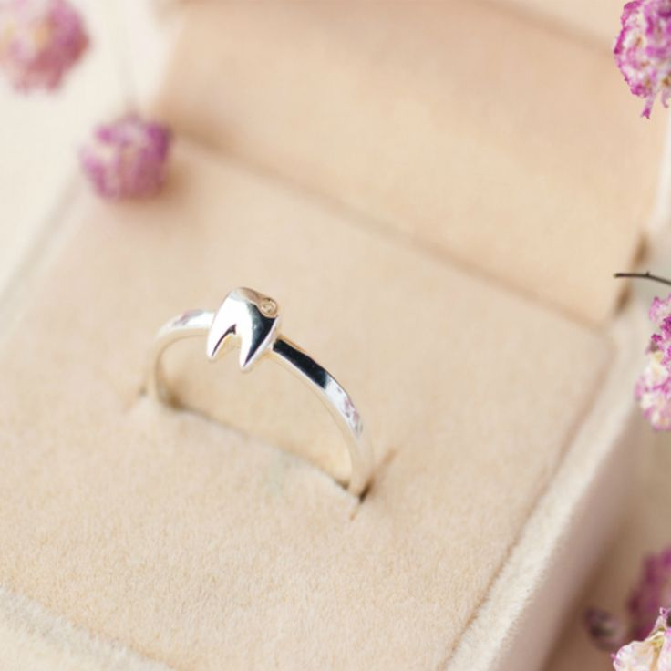 Are you a dentist? Work in the dental field? Then this beautiful tooth ring is for you! Crafted with rhodium plated sterling silver, this elegant ring is adorned with quality zirconia stone. Thanks to