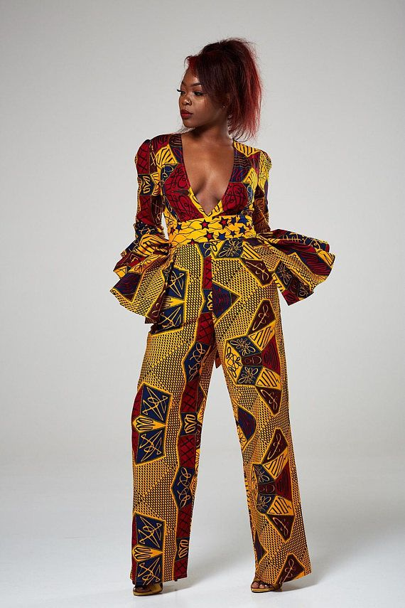 This African print deep jumpsuit is super effortless & figure flattering. Featuring a deep cut at the front to get you noticed. Looks sexy teamed up with sky high heels and a clutch. * Deep cut jumpsuit in a bold African fabric * 100% cotton; no stretch; true to size * Back zip closure with