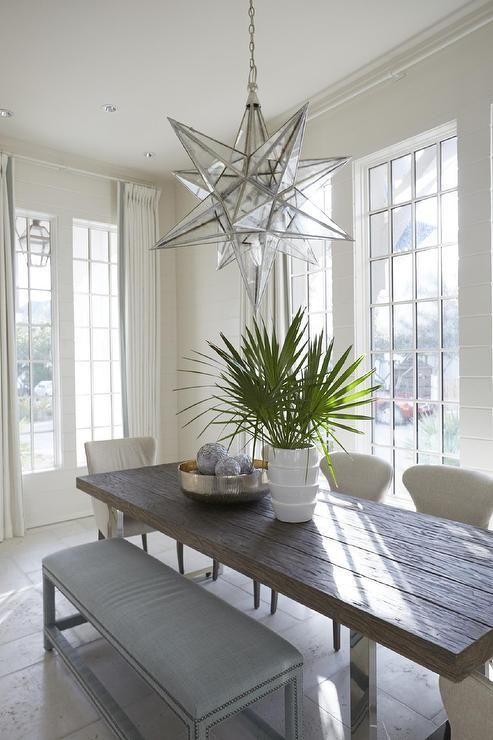 White And Blue Cottage Dining Room Features A Moravian XL Star Pendant  Illuminating A Modern Wood