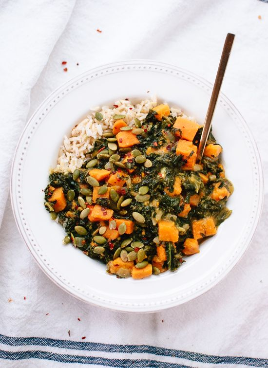 Hearty coconut curried kale and sweet potato recipe - cookieandkate.com