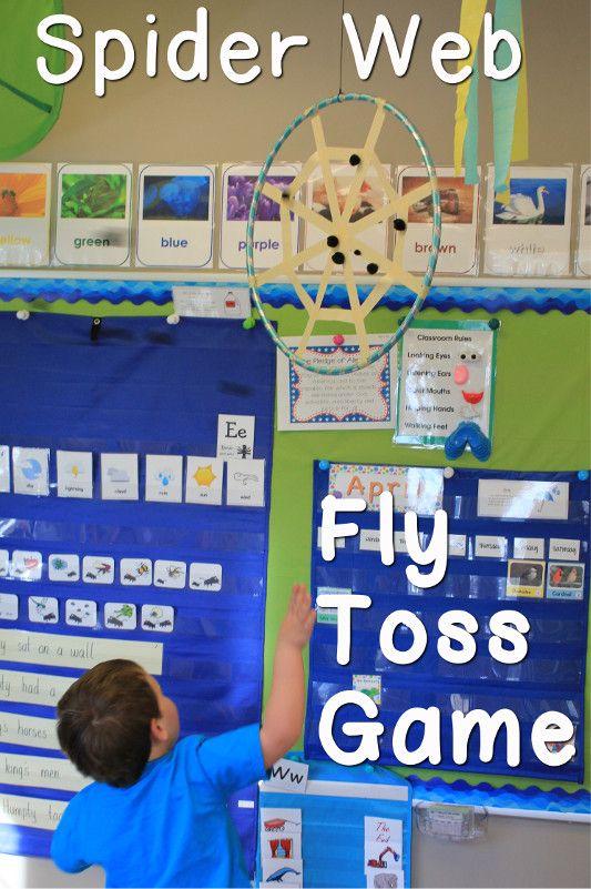 Spider Web Fly Toss Game for preschool using pom poms