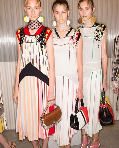 Moving on to the #MFW recap of our fave runway look on the upcoming spring/summer, here's Prada, showcasing a clever show with striped space age skirt suits and coats, Christmas decoration earrings (to die for!) gold lips, janggling sequins to dropped waist dresses.  Segued through the different refrences, but managed to make sense and appeared with cool styling details, gotta put them on shopping list next season!