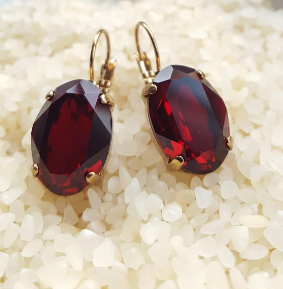 Check out this item in my Etsy shop https://www.etsy.com/ca/listing/576091461/swarovski-garnet-oval-gold-dangle