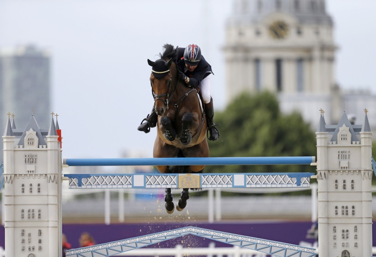 Over The Post       Peter Charles, of Great Britain, rides Vindicat, during the equestrian show jumping team competition at the 2012 Summer Olympics, Monday, Aug. 6, 2012, in London. (AP Photo/David Goldman)
