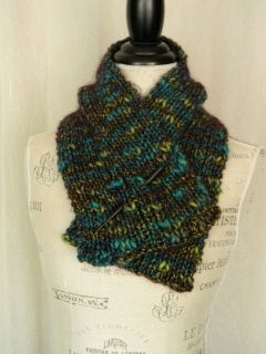This gorgeous hand knit neckwarmer scarf is so cozy, I had to knit two: one to sell, and one to keep for myself! I love the way it feels around my neck, and am sure you will, too. Handmade with a wool/acrylic blend in turquoise and green thick and thin yarn wrapped with a very deep eggplant kind of purple. Shawl stick shown is included to secure in place.  Scarves and Cowls by myMountainStudio