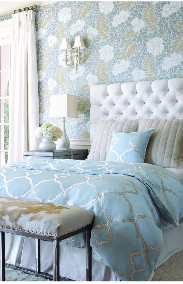 I love the soothing colors in the wallpaper and bedding.  The headboard makes the bed look so luxurious.