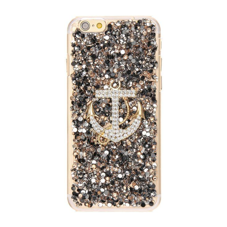Anchors aweigh with this Crystal Embellished Anchor Phone Case. This phone case features a crystal studded anchor on the back and a gold tone base. The case is bedazzled with tons of glitter and confetti. Protect your phone with this blinged out naval themed phone case.
