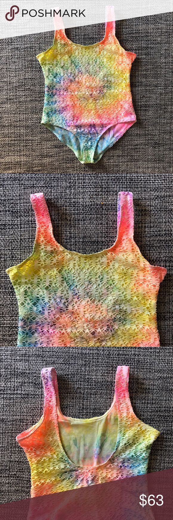 Unif Rainbow tie dye crochet bathing suit M UNIF Rainbow Tie Dye Crochet Knitted One Piece Swimsuit Swimwear size M but the torso area is really small so I only recommend for people that are shorter or have a short torso area or XS/S UNIF Swim One Pieces