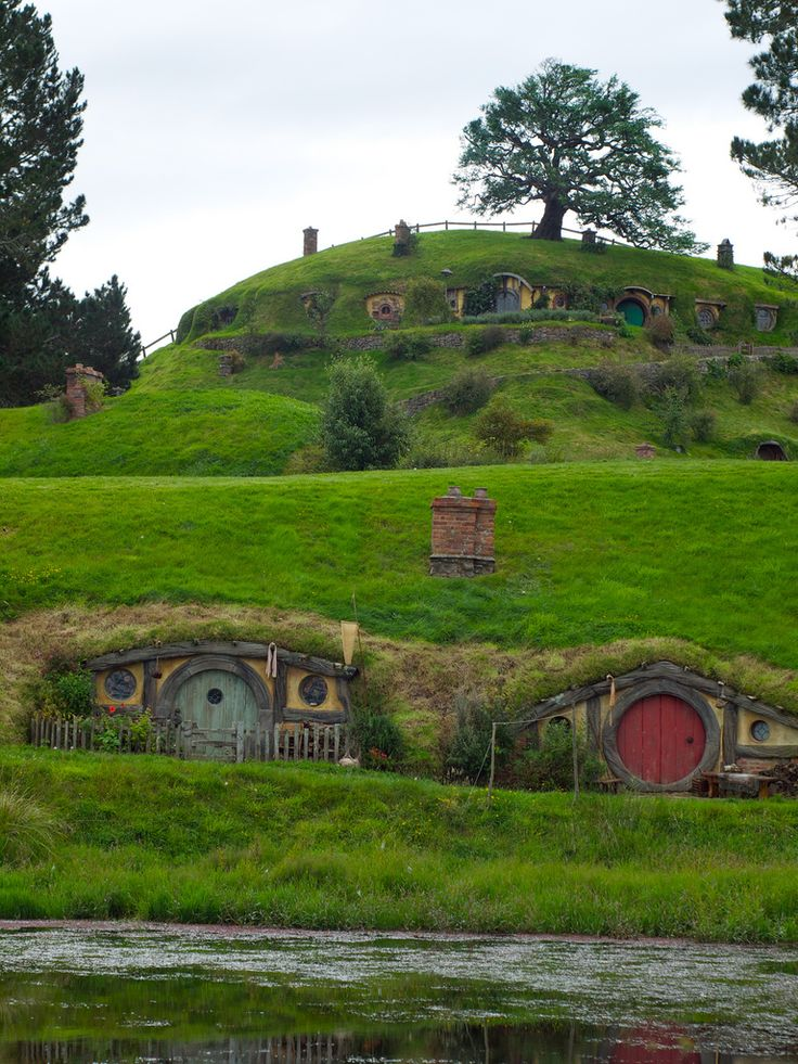 The Shire - still there in New Zealand as a tourist attraction. I would love to build a hobbit hole to live in (not hobbit-sized, of course)!