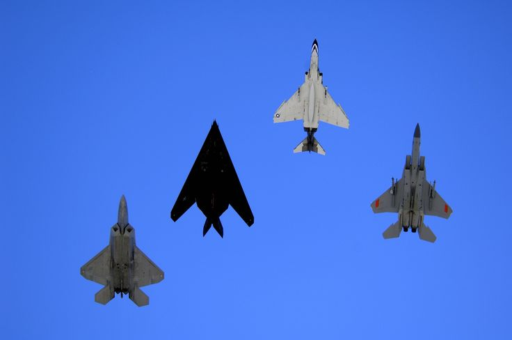 An F-22 Raptor, an F-117 Nighthawk, an F-4 Phantom and an F-15 Eagle fly over Holloman Air Force Base, N.M.