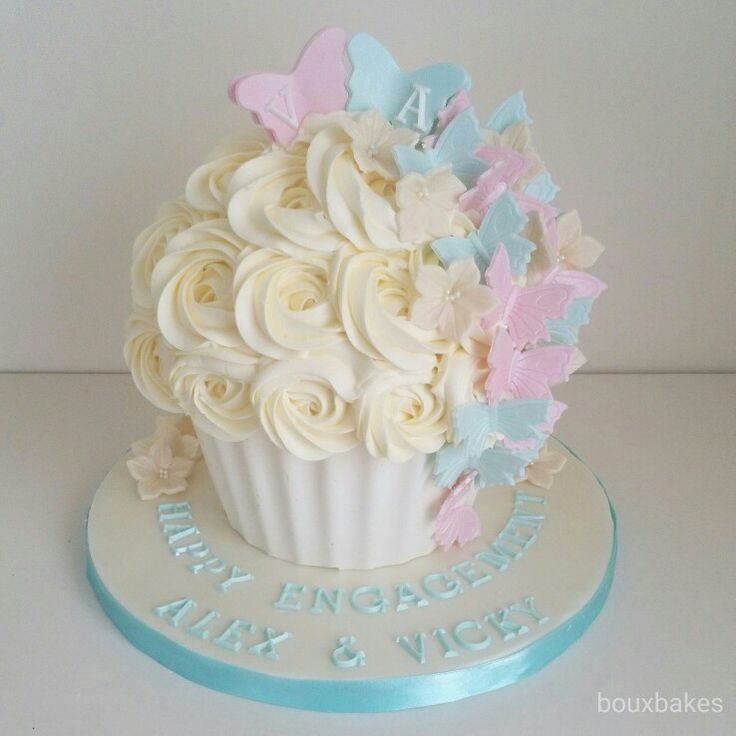 Cream, teal and pink engagement giant cupcake