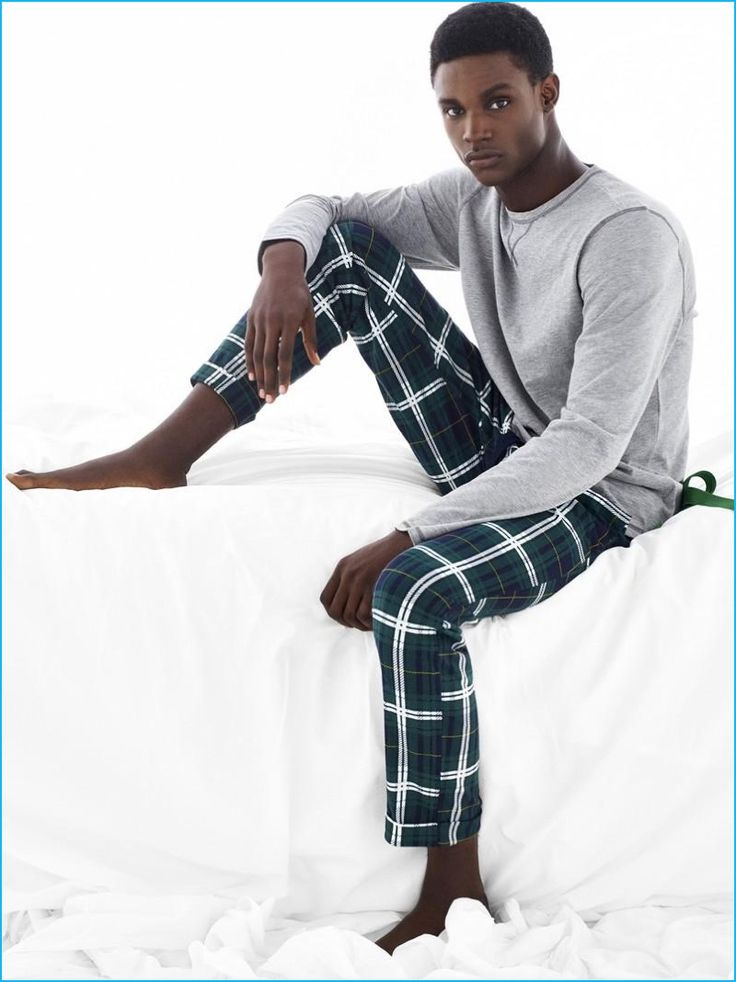 Victor Ndigwe relaxes in comfortable pajamas for Undercolors of Benetton's holiday 2016 campaign.