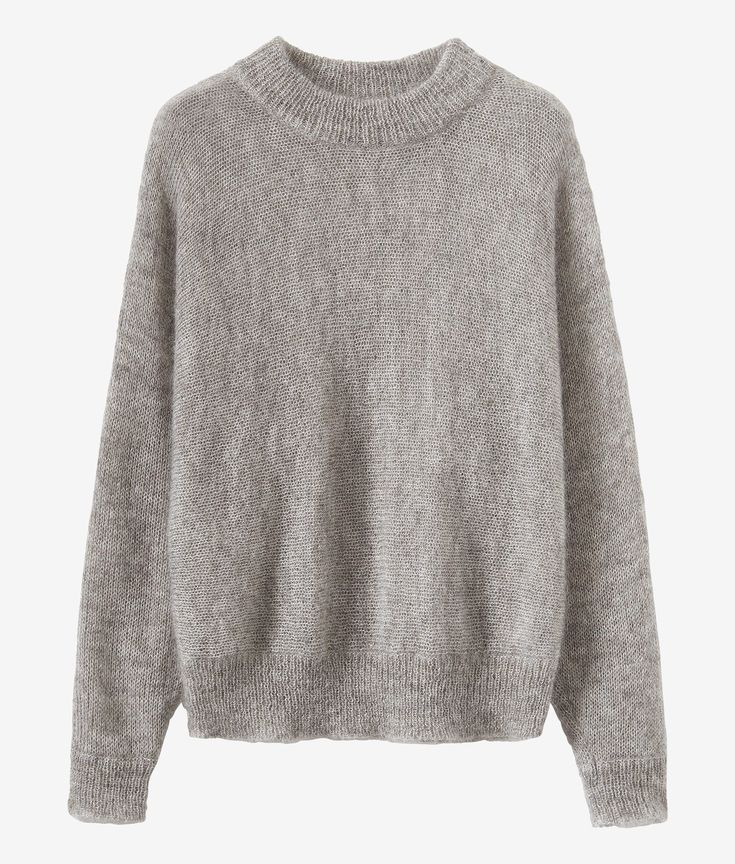 Our dolman sleeved mohair sweater is made from a soft and lightweight  mohair wool blend and has a double ribbed neckline.