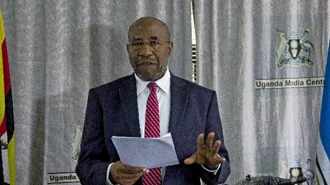 Uganda's then minister for health and current prime minister Ruhakana Rugunda addresses a press conference in Kampala on July 31, 2014