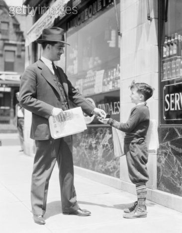 Newspaper boy selling paper to businessman, Philadelphia, ca. 1930s