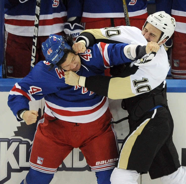 PENGUINS 6, RANGERS 3 — The Penguins' Tanner Glass (right) and the Rangers' Arron Asham drop the gloves just as the puck is dropped in the first period on Sunday, Jan. 20, 2013, at Madison Square Garden in New York.  Chaz Palla | Tribune-Review  http://triblive.com/sports/penguins/3331350-74/penguins-neal-malkin#axzz2ITAYxgJ9