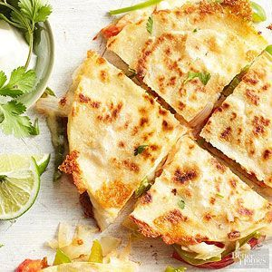 The colorful, fresh vegetables and oozy melted cheese in these fajita-style quesadillas will prove irresistible. Serve them as party appetizers or for a quick lunch on the weekend./