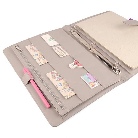 Our deluxe Original A4 Ring Binder is designed with plenty of storage space for your cell phone, ipad, business cards, presentations, notes, meeting agendas, planner pages, business cards and closes securely with a buckle.  Available in a wide variety of leather colors & may be