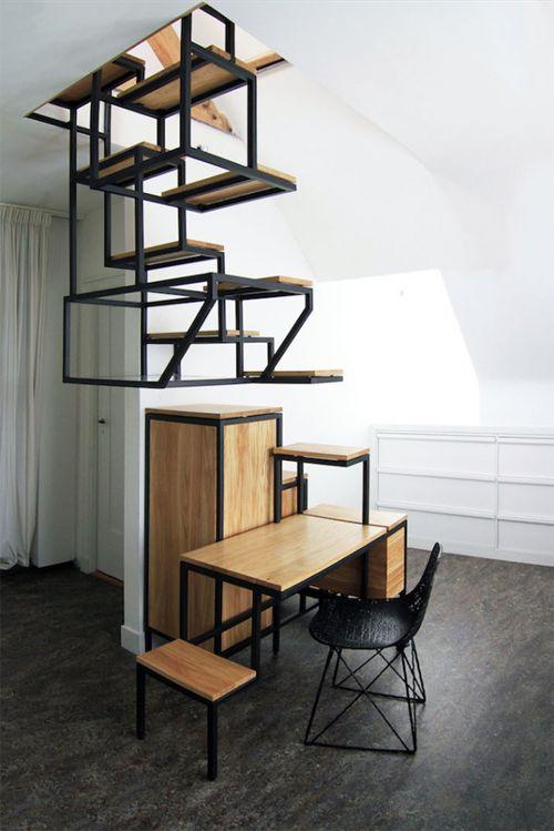 """坂井直樹の""""デザインの深読み"""": 階段のスペースを活用したデスク、ストレージをスティールのフレーム構造に板を組み合わせた縦の空間活用の良い事例。"""