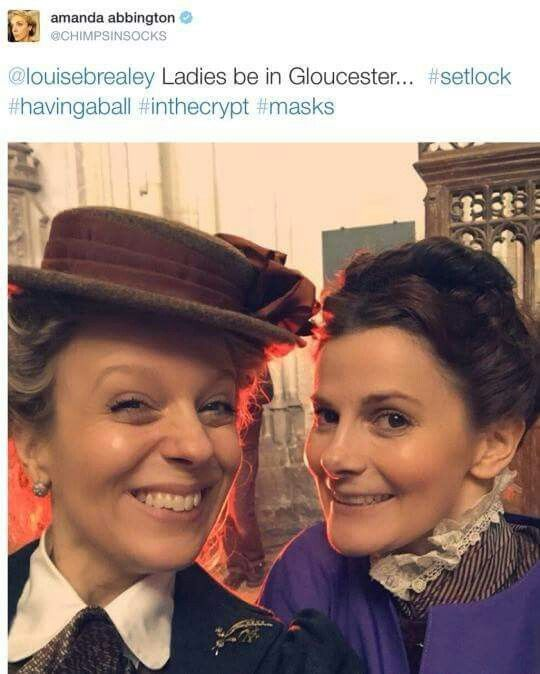 SHERLOCK (BBC) ~ Amanda Abbington (Mary) and Louise Brealey (Molly) in Victorian costume behind-the-scenes at Gloucester Cathedral on January 23, 2015 during filming of the pre-Season 4 SHERLOCK: THE SPECIAL.