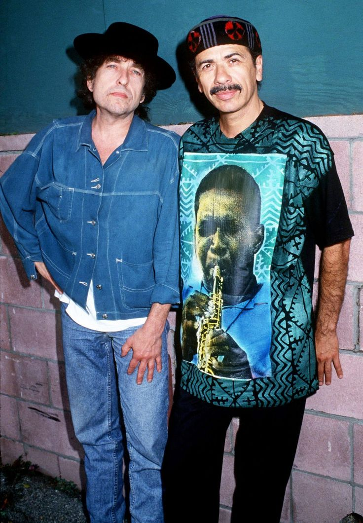 Bob Dylan and Carlos Santana (wearing John Coltrane shirt).