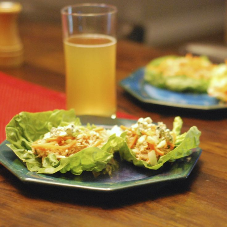 Buffalo Chicken Lettuce Wraps (from A Girl in the South). My variation is to use an already-cooked rotisserie chicken, shred it, then do half Buffalo-style and the other half in BBQ or Asian-style sauce for those who don't like Buffalo sauce.