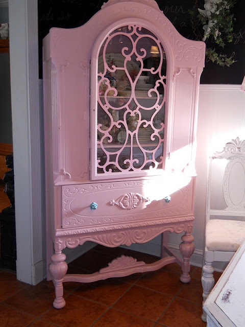 Pretty in Pink Antique China Cabinet.....I have one of these China cabinets but haven't been able to bring myself to paint it pink yet.