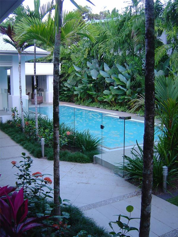 tropical poolside feel with clear fence, and direct undercover area