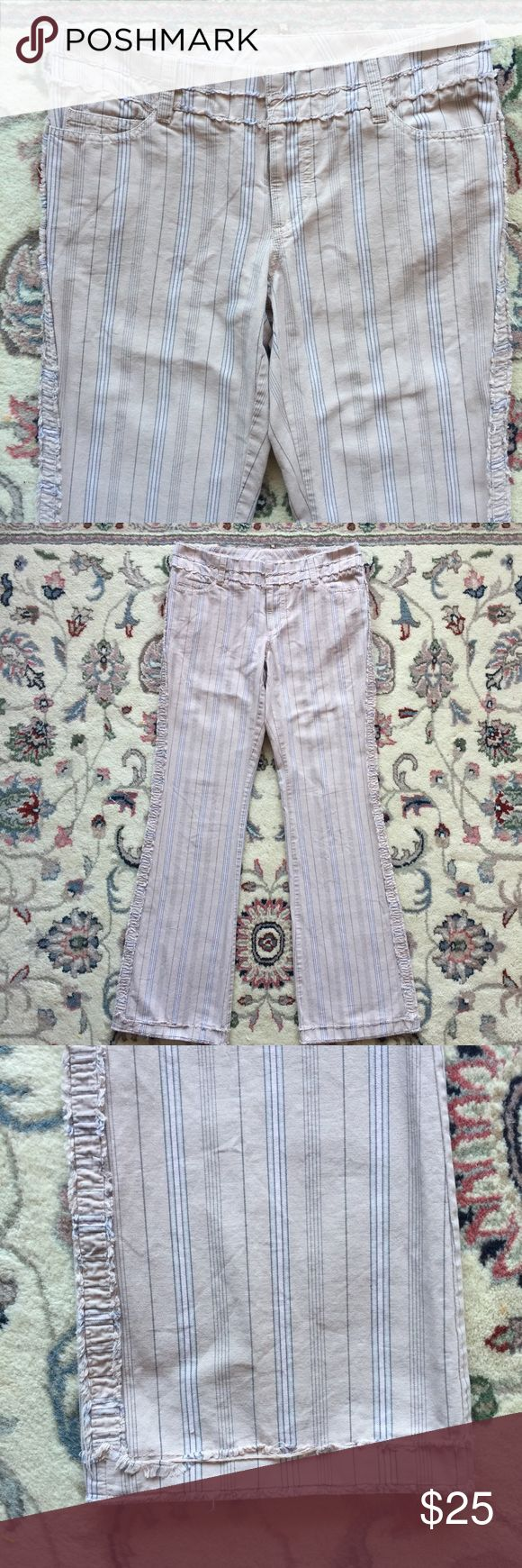 American Eagle Outfitters Fray Trim Trousers Sz 4 Light khaki color pants with pale gray and pale pink stripes. Purposely frayed trim on Waist and, side seams, and cuffs. Fabric 100% cotton. Waist measures 31 inches. Rise is 8 inches. Inseam is 31 inches. Leg opening is 9 1/2 inches. Excellent condition. American Eagle Outfitters Pants Trousers