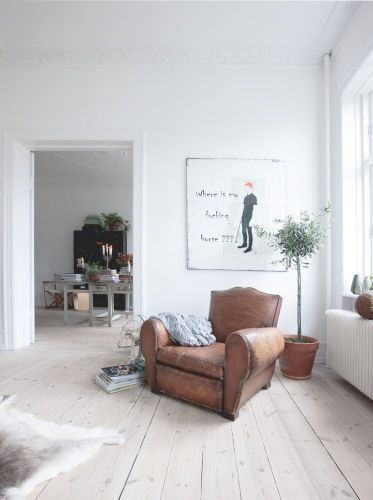 Light leather chair with while walls