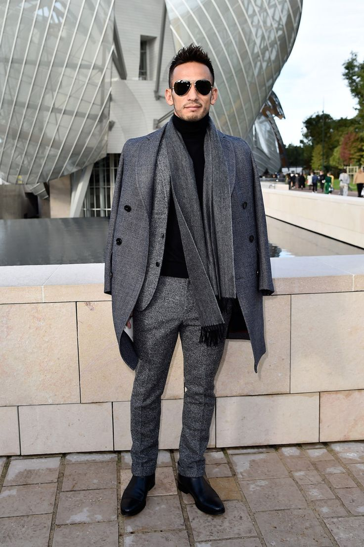 At this point Hidetoshi Nakata might be better known for sitting in the front rows of international fashion shows than he is for how he got famous in the first place: being Japan's answer to David Beckham. He scores points for tonality; the best way to make tweed, herringbone, and the Prince of Wales check work together is to make sure they come from the same color family.