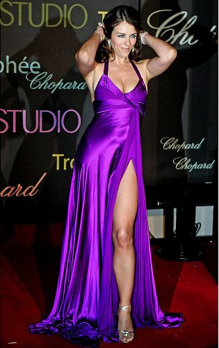 Elizabeth Hurley's purple gown shows off her gorgeous gams