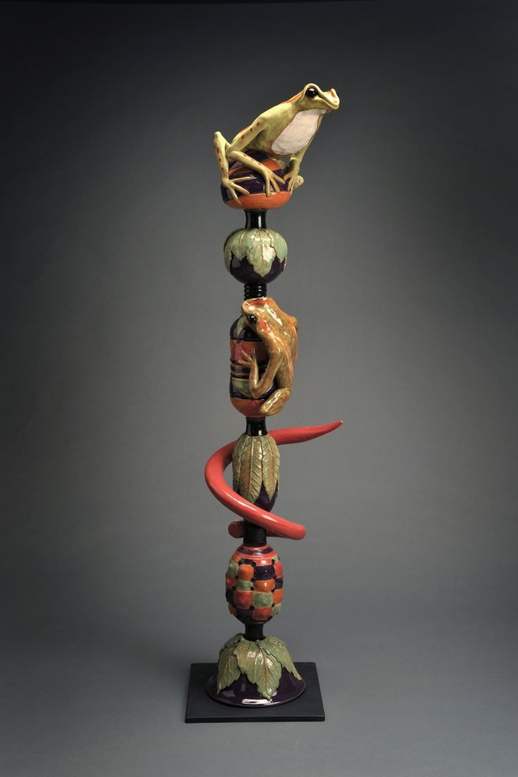 I like the perched frogs, use of leaves and the red horn-like element