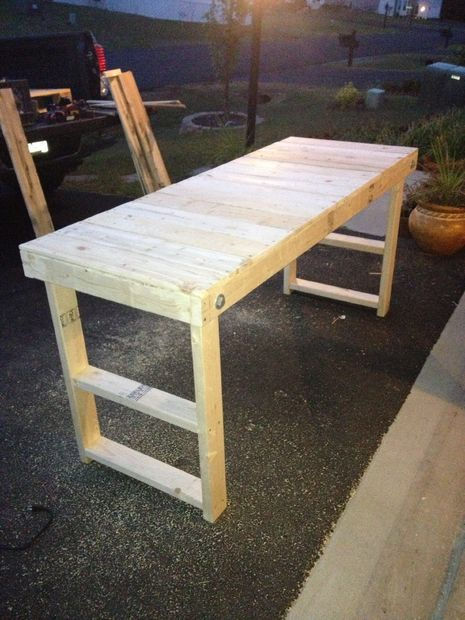 "Easy, Cheap Folding Workbench. Materials: -4x 2""x4""x48"" -pallet wood (thin) -screws -4 nuts -4 bolts -8 washers"