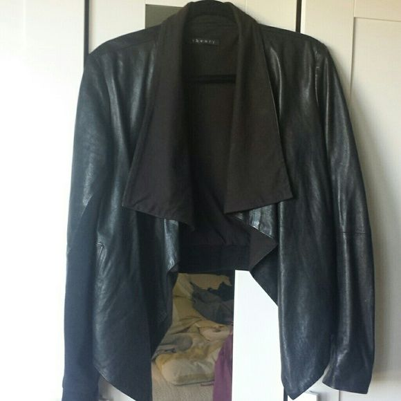 Theory leather jacket Beautiful theory leather and cotton jersey jacket.  The cotton part of the jacket has faded in color a bit but still in great condition. Also, the stitching behind the collar is slightly coming loose but this should be an easy repair.  Also, size tag is missing but fits like a large. Theory Jackets & Coats