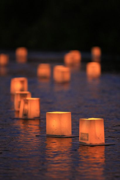 """Toro nagashi in Hachioji, Japan - Tōrō nagashi (灯籠流し) is a Japanese ceremony in which participants float paper lanterns (chōchin) down a river; tōrō is traditionally another word for lantern, while nagashi means """"cruise, flow"""". This is primarily done on the last evening of the Bon Festival festival based on the belief that this guides the spirits of the departed back to the other world"""