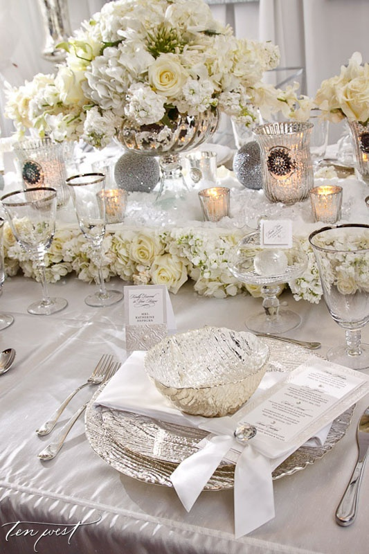 Beautiful all white table setting with textured menu cards
