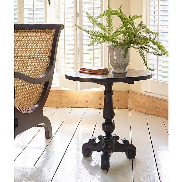 Carved Side Table. Our Keraton Carved round side table, handcrafted in Indonesia from solid teak with a rich dark brown stain, is a striking addition for any room in your home.