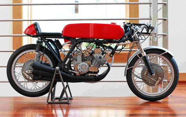 1960's Honda RC166 a vintage racer and the exact bike the model was used to copy. Its impossible to tell the 2 apart.