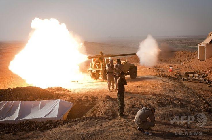イラク北部サラハディン(Salaheddin)州ツズフルマツ(Tuz Khurmatu)で起きたイスラム教スンニ派(Sunni)の過激派組織「イスラム国(Islamic State、IS)」との激しい衝突で、無反動砲を発砲するシーア派(Shiite)民兵(2014年8月31日撮影)。(c)AFP/JM Lopez ▼1Sep2014AFP|イラク軍、北部アミルリで過激派の包囲突破 http://www.afpbb.com/articles/-/3024577