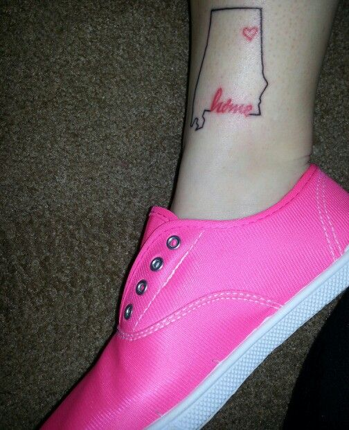 Tattoo of the alabama state outline with the heart on my hometown.