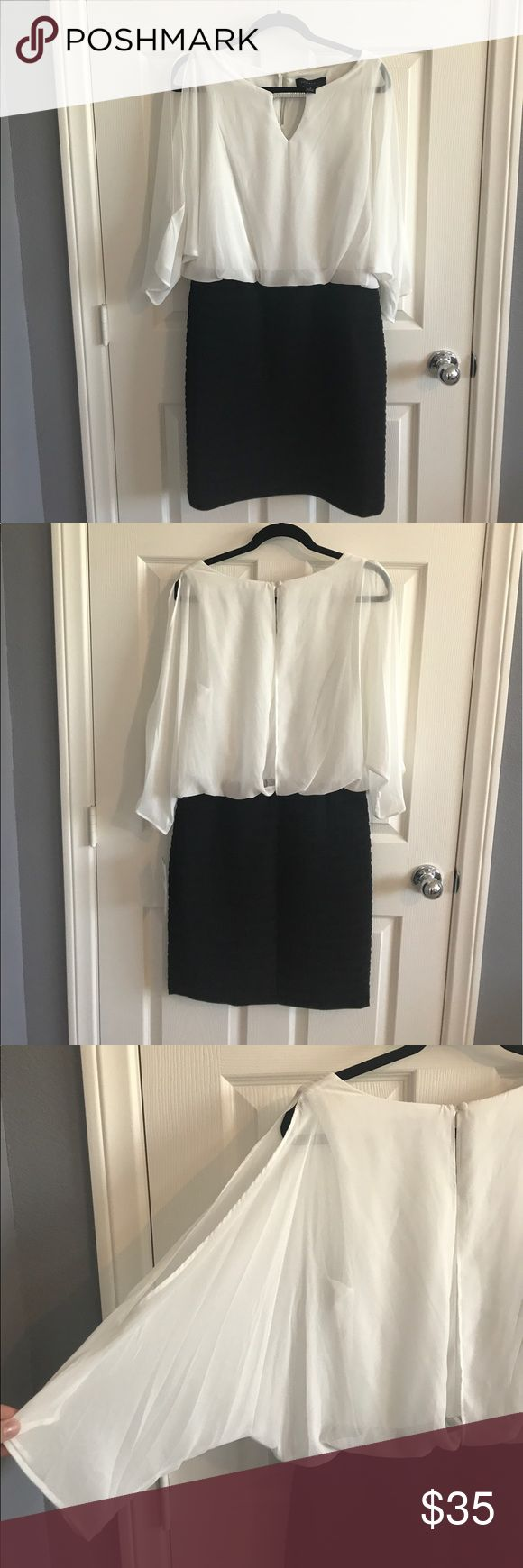 🌟SALE🌟 Semi-Formal Dress • Scarlett NWT • BEAUTIFUL Dress with on trend details in the sleeves, neckline, and back • Black and white • Loose fitting top portion is flattering for all • Size 10 • Never been worn • Scarlett Dresses