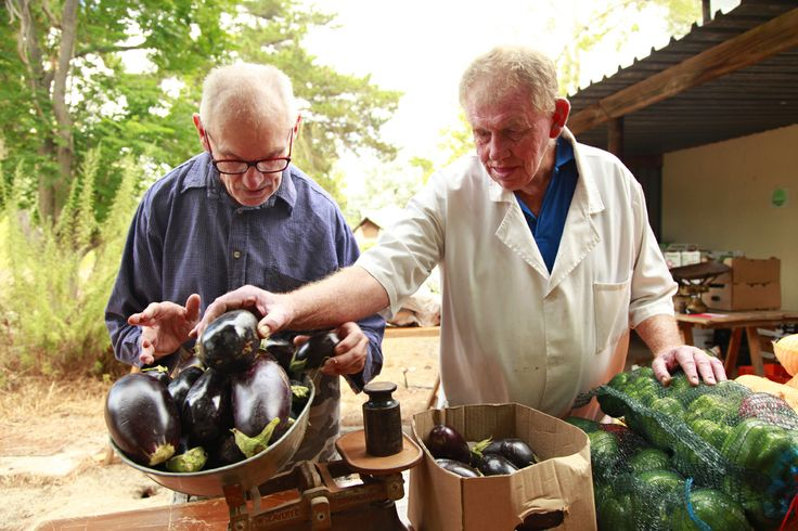 Residents sorting and weighing fresh produce for delivery around the village.