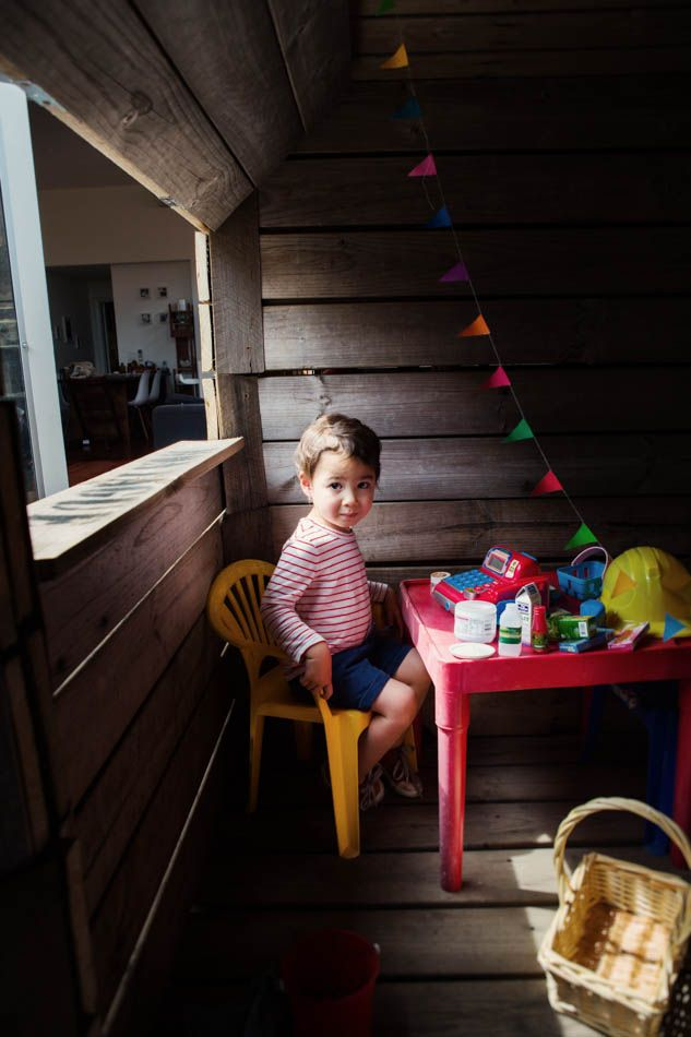Kids in Cubby Houses. Pops of colour and paper bunting a simple but very effective cubby house interior.