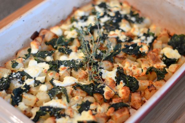 Roasted potatoes and kale with feta cheese.