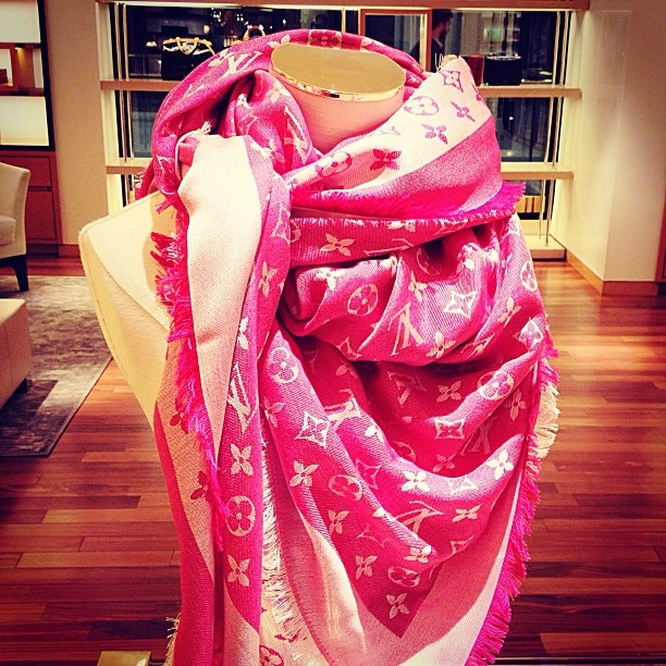 Pink louis vuitton scarve.