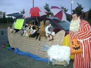 I could see doing something like this but maybe at the trunk end and having the animals in the trunk.  Ooooo - how about using table cloths to make the WHOLE CAR a boat and taping pictures of animals in the windows, then the trunk is the opening of the ark!  Cool idea for Trunk or Treat!