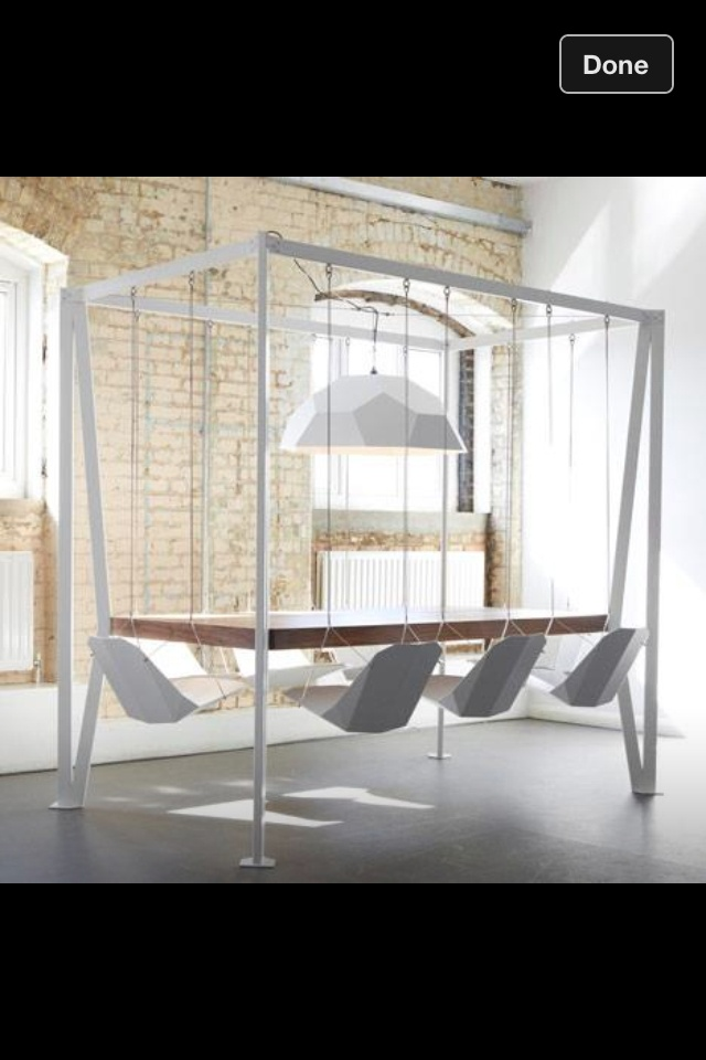Created by British furniture designer Christopher Duffy of Duffy London,  the table set features swings instead of chairs.