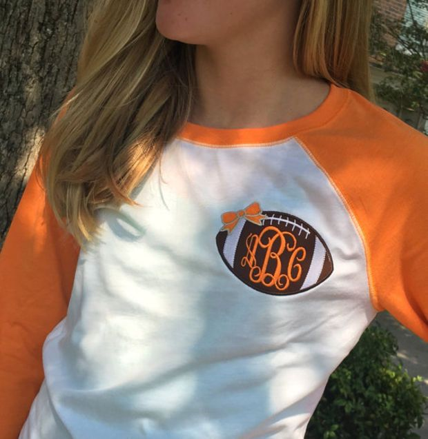 Three quarter Sleeve Raglan Orange/White Tennessee Vols Tee Monogram Football Appliqué   Font shown INTERLOCKING in orange